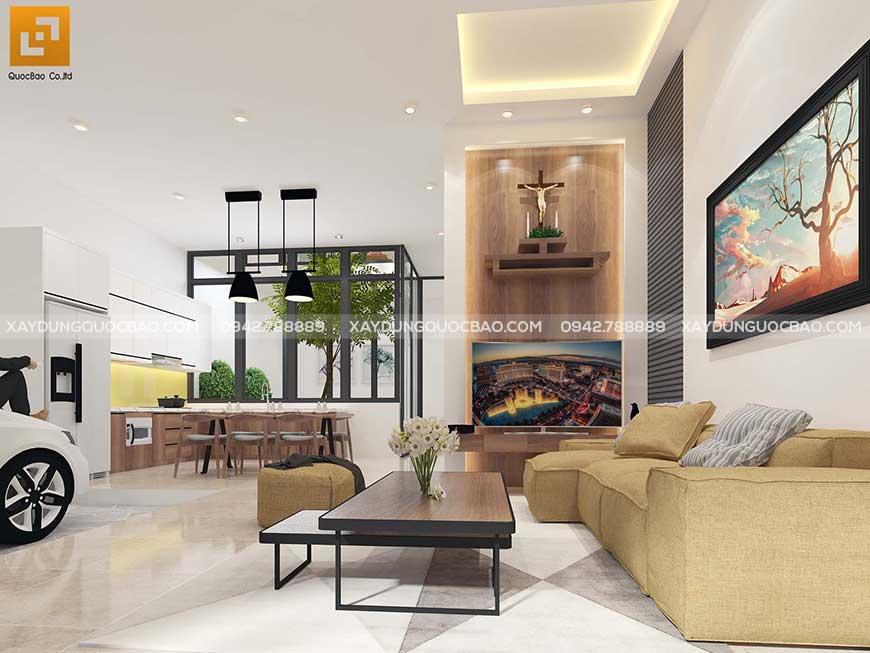 Phòng khách bố trí bộ bàn ghế sofa hiện đại, kèm chiếc gỗ đơn giản, tranh trang trí treo tường, tivi và kệ thờ đặt âm tường
