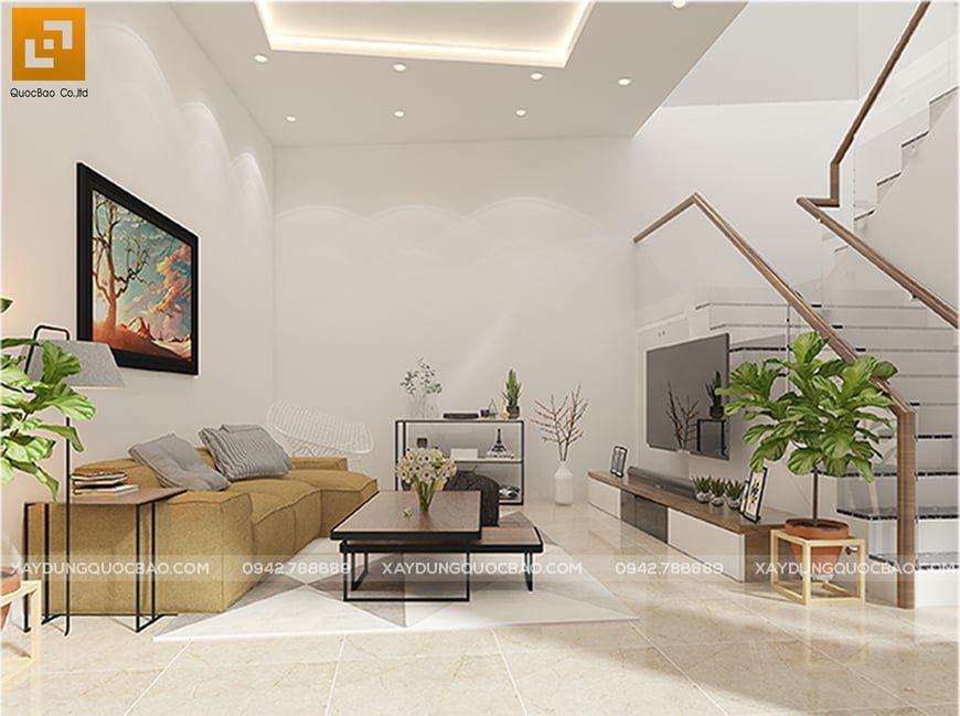 Phòng khách sử dụng bộ bàn ghế sofa gọn gàng, họa tiết trang trí bắt mắt