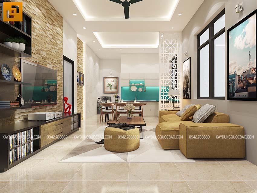 Phòng khách Biệt thự nổi bật với gạch ốp lát, kệ tivi, bộ bàn ghế sofa bắt mắt