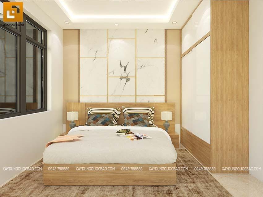 Phòng ngủ dùng gam màu ấm áp, sàn được lót thảm
