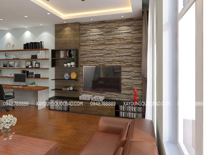 Phòng làm việc của 2 vợ chồng anh Minh được sắp xếp chung không gian phòng khách