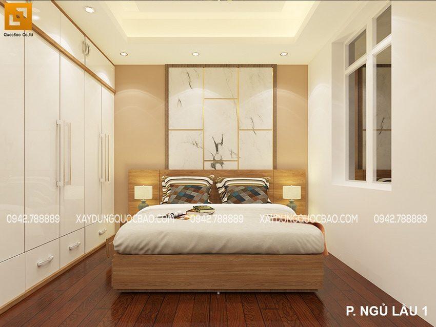 Phòng ngủ dành cho khách được phối màu vân gỗ sáng và đen giúp cho căn phòng trở nên rộng rãi