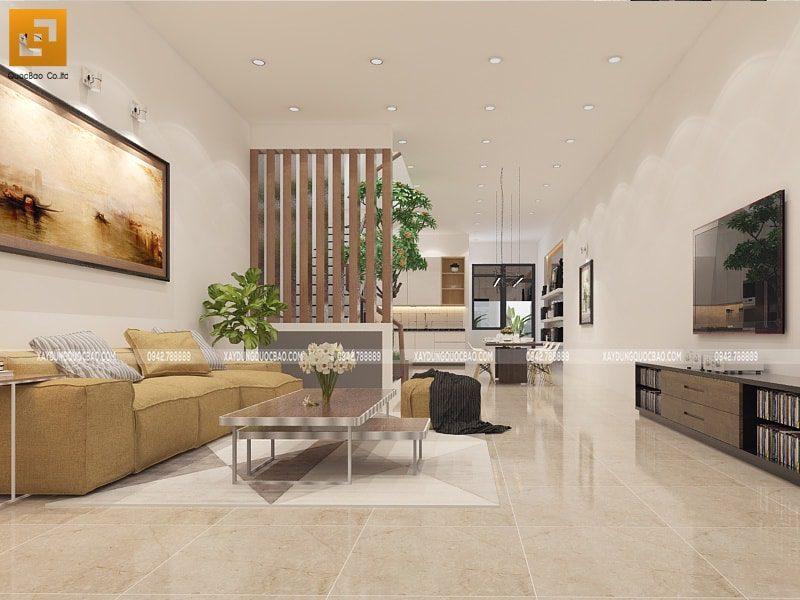 Phòng khách rộng rãi gồm 1 bộ  bàn ghế sofa, kệ để tivi, bức tranh nghệ thuật treo tường cỡ lớn