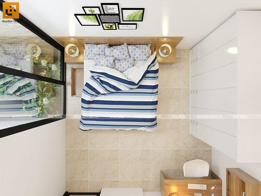Thiết kế nội thất phòng ngủ dành cho bé trai có cửa sổ mở ra không gian giếng trời