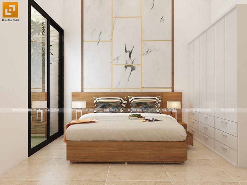 Thiết kế nội thất phòng ngủ master của chủ nhân căn nhà. Căn phòng có lối ra giếng trời trồng tiểu cảnh cây xanh trong nhà