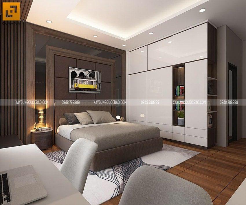 Giữa phòng trang trí bức tranh nghệ thuật khổ lớn, sàn phòng ngủ được ốp gỗ cao cấp