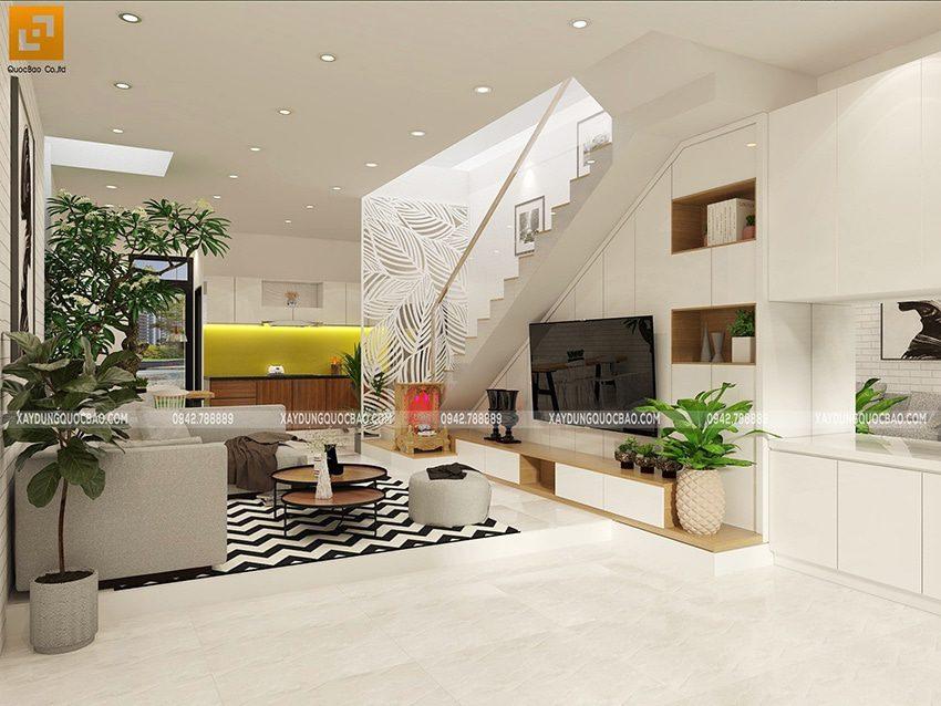 Phòng bếp và phòng khách được thông với nhau tạo cảm giác rộng rãi cho căn nhà
