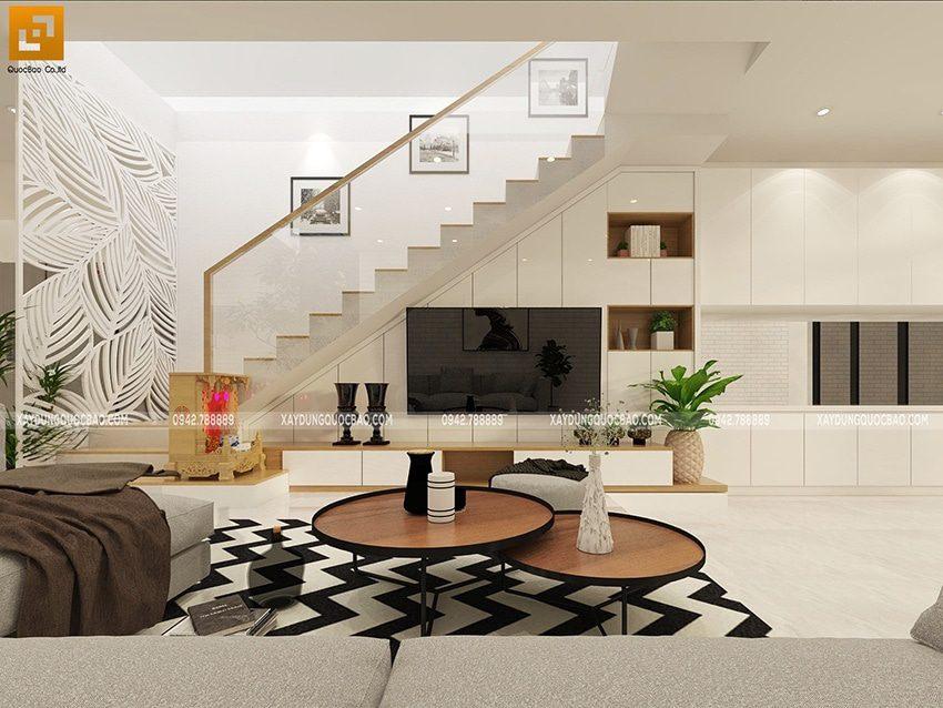 Kiến trúc sư thiết kế thêm 1 phương án cầu thang trong phòng khách sử dụng kính trong suốt thay vì nan bằng sắt