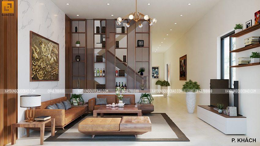 Phòng khách sử dụng nhiều vật dụng làm từ gỗ giá trị cao, trang trí sang trọng