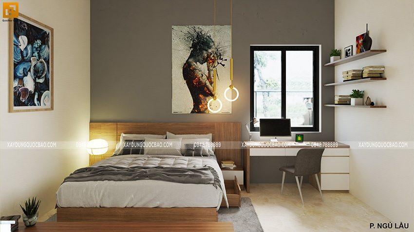 Phòng ngủ mang đậm cá tính mạnh mẽ với những bức tranh treo tường trẻ trung, hiện đại.