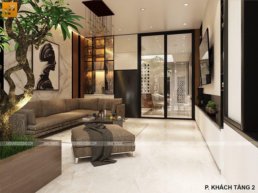 Phòng khách rộng rãi ở chính giữa tầng 2 bố trí 1 bộ bàn ghế sofa cao cấp, tủ rượu quý