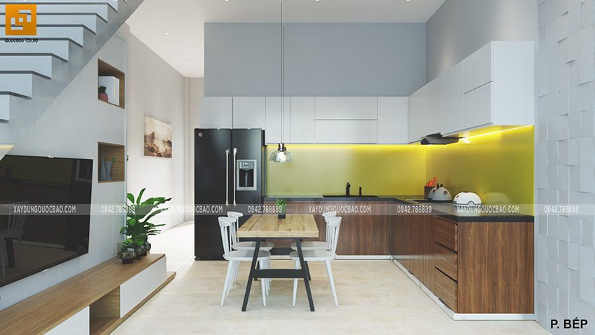 Khu vực nhà bếp tiếp nối với phòng khách giúp không gian trông rộng rãi hơn. Một bộ bàn ghế kê ở giữa bếp để gia đình quây quần bên bữa ăn.