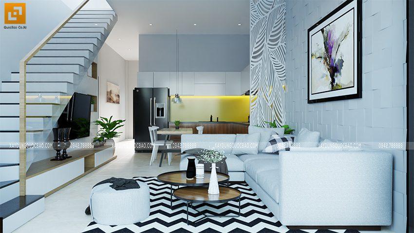 Bộ bàn ghế sofa cao cấp đặt ở chính giữa phòng khách, trên tường trang trí bức tranh nghệ thuật.