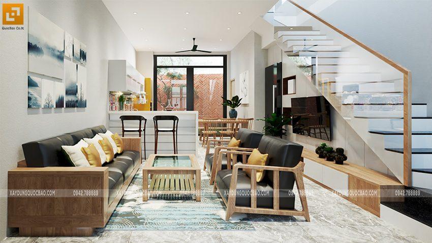 Phòng khách của nhà chị Thư nổi bật với bộ bàn ghế sofa sang trọng. Quầy bar bếp vừa trang trí không gian bếp vừa là vách ngăn giữa các phòng.