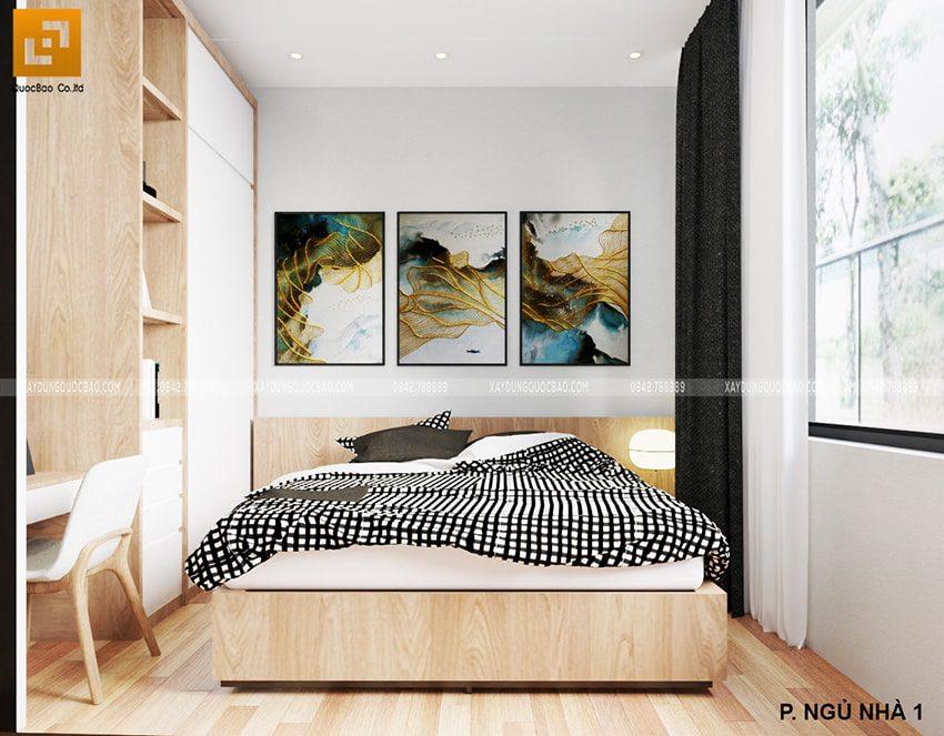 Phòng ngủ đầy đủ tiện nghi với tủ quần áo xếp gọn gàng, kệ tivi, đèn đọc sách, tranh treo tường