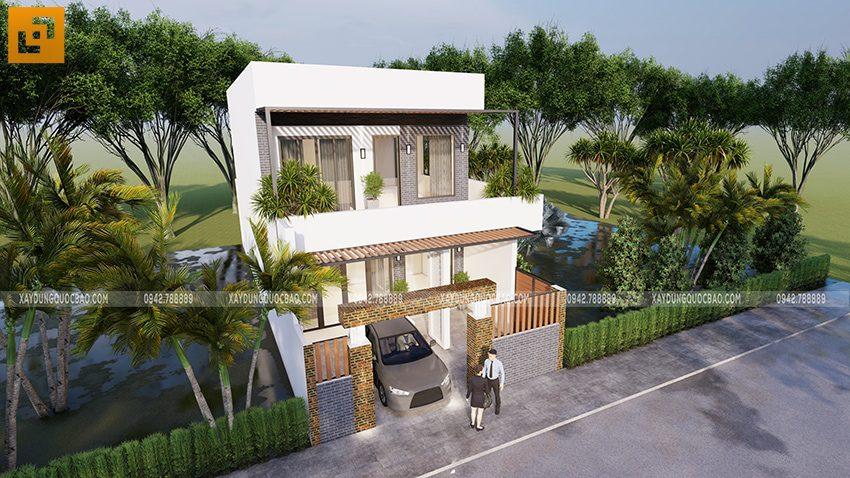 Nhà 2 tầng có gara ô tô đậu trong sân, phía trên có mái che trồng giàn cây leo xanh mát