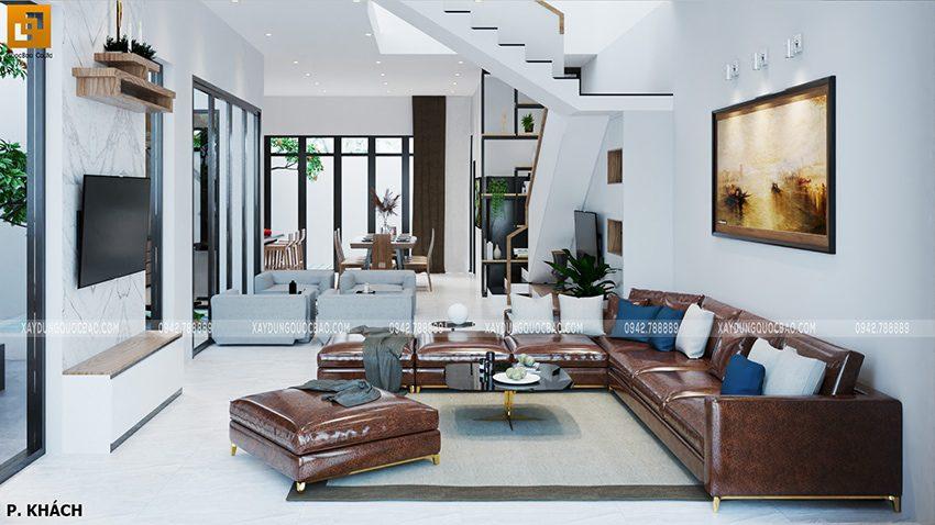 Phòng khách rộng rãi, kê bộ ghế sofa bằng da cao cấp ngay giữa phòng