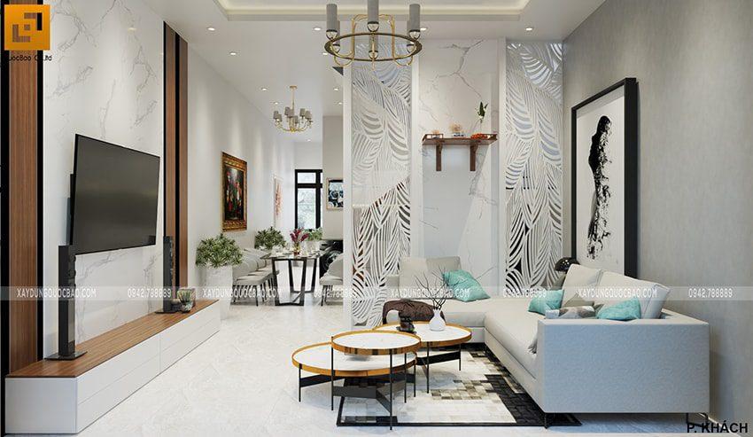 Phòng khách nhà 3 tầng rộng rãi, bộ bàn ghế cao cấp ngay giữa phòng là điểm nhấn mạnh mẽ
