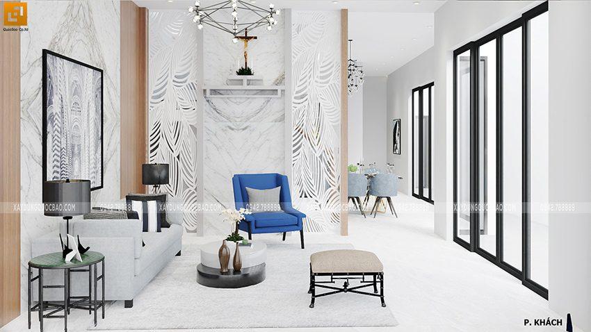 Phòng khách nổi bật với 1 bộ bàn ghế sofa lớn, vách ngăn phòng khách và cầu thang được tiện CNC lạ mắt