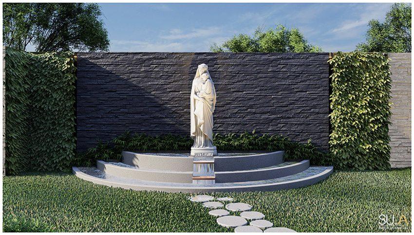 Bức tượng đá Đức Mẹ Maria tạc từ đá nguyên khối đặt chính giữa đài nước ở một góc trang trọng trong sân vườn