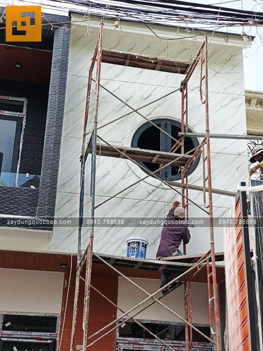 Hoàn thiện ốp gạch mặt tiền nhà 3 tầng - Ảnh 3