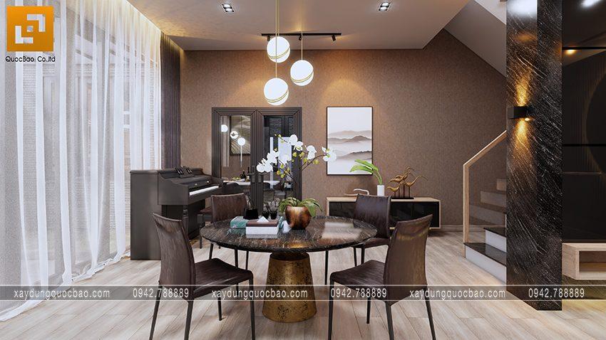 Góc không gian phụ bố trí 1 bộ bàn trà, cây đàn piano kê ở góc phòng gợi đến hương vị hoài cổ cho phòng khách