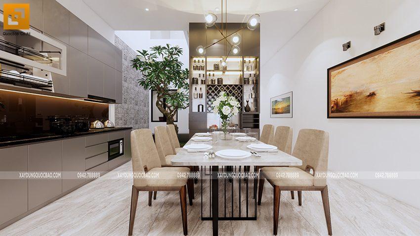 Bộ bàn ăn kê chính giữa nhà bếp thuận tiện cho bữa cơm gia đình